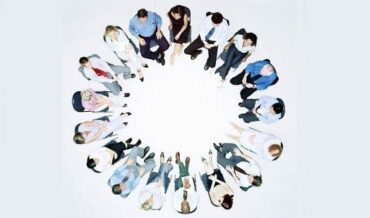 Group of people sitting in circle, overhead view